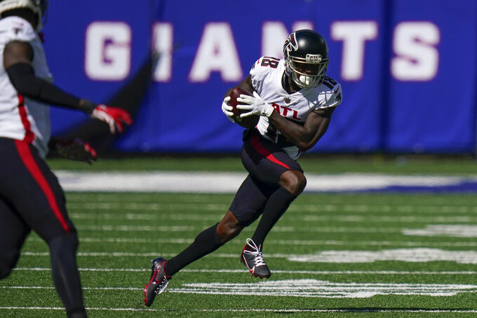 Atlanta Falcons wide receiver Calvin Ridley (18) runs the ball during the first half of an NFL football game against the New York Giants, Sunday, Sept. 26, 2021, in East Rutherford, N.J. (AP Photo/Seth Wenig)