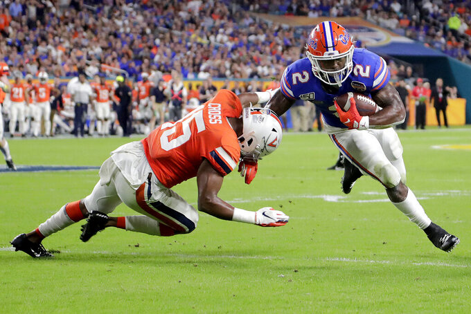 FILE - In this Dec. 30, 2019, file photo, Florida running back La'Mical Perine (2) runs past Virginia safety De'Vante Cross (15) during the first half of the Orange Bowl NCAA college football game in Miami Gardens, Fla. The New York Jets selected Perine in the fourth round of the NFL football draft on Saturday, April 25, 2020. (AP Photo/Lynne Sladky, File)