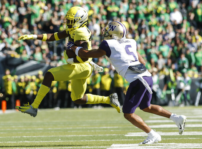 Oregon wide receiver Jaylon Redd (30), outruns Washington defensive back Myles Bryant (5), during an NCAA college football game in Eugene, Ore., Saturday, Oct. 13, 2018. (AP Photo/Thomas Boyd)