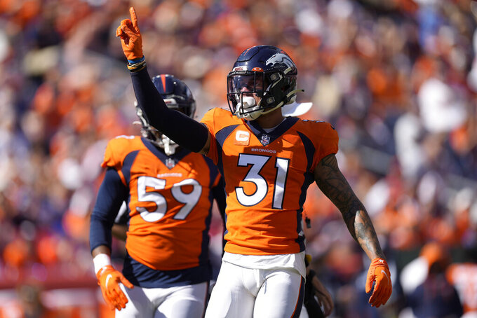Denver Broncos free safety Justin Simmons (31) celebrates a defensive stop against the New York Jets during the first half of an NFL football game, Sunday, Sept. 26, 2021, in Denver. (AP Photo/David Zalubowski)