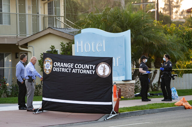 Investigators work in front of Hotel Miramar in San Clemente, Calif., Wednesday, Sept. 23, 2020, where Orange County sheriff's deputies shot and killed a Black man after he allegedly tried to grab one of their guns during a struggle, authorities said. (Mindy Schauer/The Orange County Register via AP)