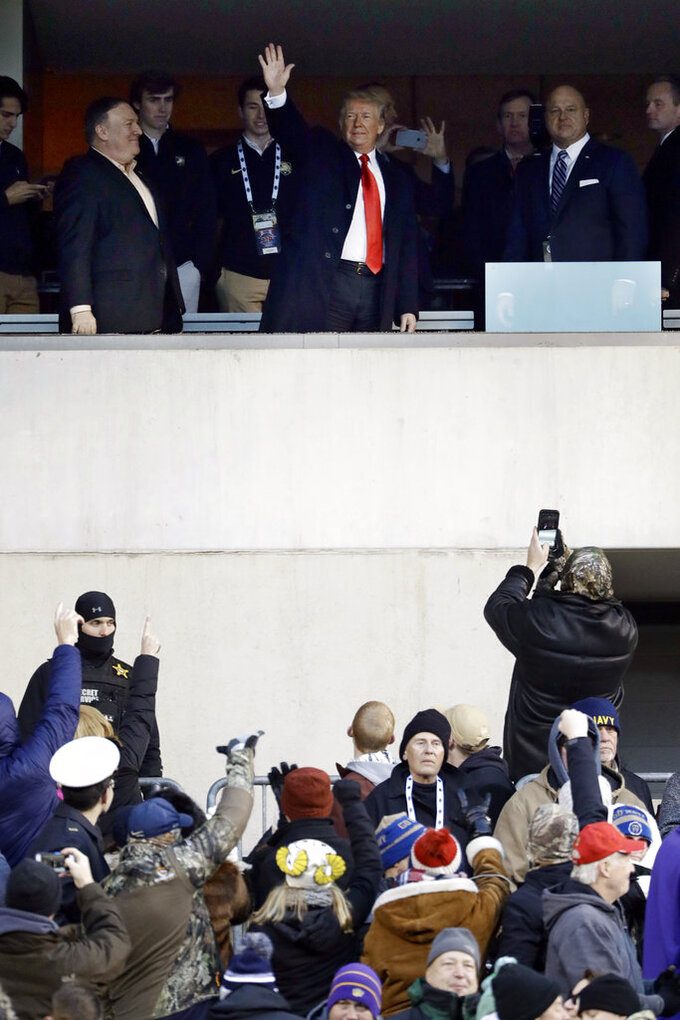 President Donald Trump, top center, waves to the crowd during the first half of an NCAA college football game between Army and Navy, Saturday, Dec. 8, 2018, in Philadelphia. (AP Photo/Matt Slocum)