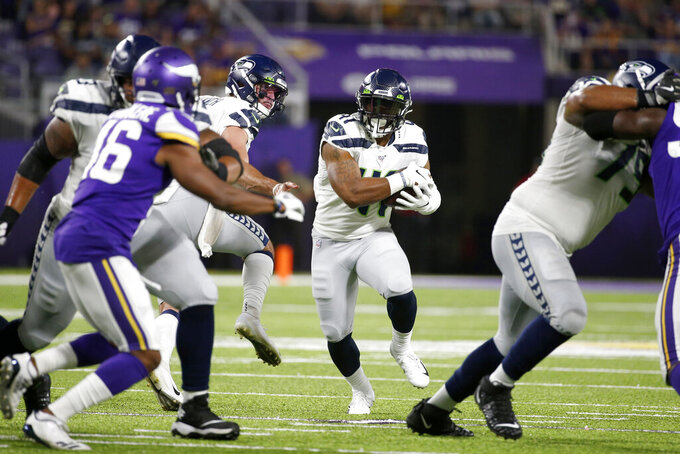 Seattle Seahawks running back Xavier Turner, center, carries the ball during the second half of an NFL preseason football game against the Minnesota Vikings, Sunday, Aug. 18, 2019, in Minneapolis. (AP Photo/Bruce Kluckhohn)