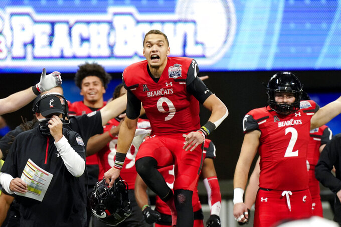 Cincinnati quarterback Desmond Ridder (9) reacts to a Georgia fumble during the second half of the Peach Bowl NCAA college football game, Friday, Jan. 1, 2021, in Atlanta. (AP Photo/Brynn Anderson)
