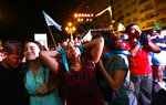 Anti-abortion activists react after lawmakers passed a bill that legalizes abortion, outside Congress in Buenos Aires, Argentina, Wednesday, Dec. 30, 2020. (AP Photo/Marcos Brindicci)