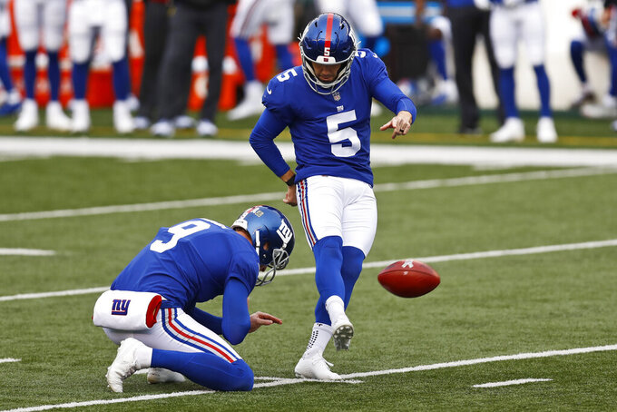 New York Giants kicker Graham Gano (5) boots a 40-yard field goal during the second half of NFL football game against the Cincinnati Bengals, Sunday, Nov. 29, 2020, in Cincinnati. (AP Photo/Aaron Doster)
