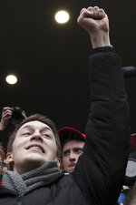 Moscow student Yegor Zhukov gestures after his trial in Moscow, Russia, Friday, Dec. 6, 2019. The court on Friday gave student vlogger Zhukov a three-year suspended sentence and banned him from administering websites for two years on charges of inciting protests. He is among several dozen people who faced charges for their role in the past summer's protests in Moscow. (AP Photo)