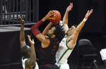 Oregon forward Eugene Omoruyi (2) challenges Stanford guard Bryce Wills (2) along with Oregon guard Chris Duarte (5) during the second half of an NCAA college basketball game Saturday, Jan. 2, 2021 in Eugene, Ore. Oregon won the game 73-56. (AP Photo/Andy Nelson)