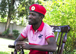 Pop star-turned-opposition lawmaker Bobi Wine, whose real name is Kyagulanyi Ssentamu, is seen while giving an interview to Associated Press at his home, in Magere in Kampala, Uganda, Monday, July 15, 2019. Bobi Wine, Uganda's pop star-turned-opposition leader, says he will challenge longtime President Yoweri Museveni in polls set for 2021. But Wine, says he is concerned about his safety.(AP Photo/Ronald Kabuubi)