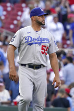 Los Angeles Dodgers' Albert Pujols walks out to celebrate with teammates following a 5-1 victory over the St. Louis Cardinals in a baseball game Monday, Sept. 6, 2021, in St. Louis. (AP Photo/Jeff Roberson)
