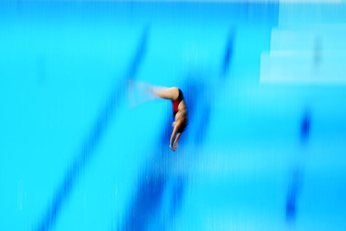 Pamela Ware, of Canada, competes in women's diving 3-meter springboard preliminary at the 2020 Summer Olympics, Friday, July 30, 2021, in Tokyo. (AP Photo/David Goldman)