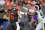 Cleveland Browns quarterback Baker Mayfield (6) looks to throw under pressure from Los Angeles Rams defensive end Dante Fowler during the first half of an NFL football game Sunday, Sept. 22, 2019, in Cleveland. (AP Photo/David Richard)