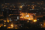 A view of the town of Ceylanpinar, Sanliurfa province, southeastern Turkey, near the Syrian border, hours before a five-day cease-fire in northern Syria between Turkish troops and Syrian Kurdish fighters was set to expire, Tuesday, Oct. 22, 2019. Turkish President Recep Tayyip Erdogan says Turkey and Russia have reached a deal under which Syrian Kurdish fighters will move 30 kilometers away from a border area in northeast Syria within 150 hours. (AP Photo/Lefteris Pitarakis)