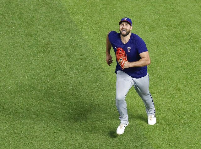 Texas Rangers outfielder Joey Gallo chases a fly ball during a