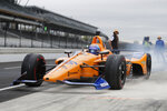 IndyCar driver Fernando Alonso, of Spain, drives out of the pit area during testing at the Indianapolis Motor Speedway in Indianapolis, Wednesday, April 24, 2019. (AP Photo/Michael Conroy)