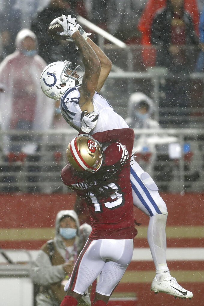 Indianapolis Colts wide receiver Michael Pittman Jr., top, catches a touchdown pass over San Francisco 49ers cornerback Dre Kirkpatrick (13) during the second half of an NFL football game in Santa Clara, Calif., Sunday, Oct. 24, 2021. (AP Photo/Jed Jacobsohn)