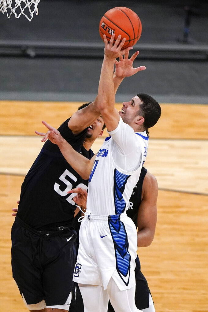 Creighton's Marcus Zegarowski, right, drives past Butler's Jair Bolden during the second half of an NCAA college basketball game in the Big East men's tournament Thursday, March 11, 2021, in New York. (AP Photo/Frank Franklin II)