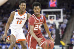 Oklahoma guard Jamal Bieniemy (24) dribbles the ball against Virginia guard De'Andre Hunter (12) during the first half of a second-round game in the NCAA men's college basketball tournament Sunday, March 24, 2019, in Columbia, S.C. (AP Photo/Sean Rayford)