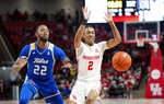 Houston's Caleb Mills (2) loses the ball as Tulsa's Reggie Jones (22) defends during the first half of an NCAA college basketball game Wednesday, Feb. 19, 2020, in Houston. (AP Photo/David J. Phillip)