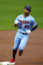 Minnesota Twins' Byron Buxton rounds third base on a solo home run off Detroit Tigers pitcher Tarik Skubal in the first inning of a baseball game Tuesday, Sept. 22, 2020, in Minneapolis. (AP Photo/Jim Mone)