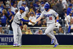 Los Angeles Dodgers' Will Smith, right, reacts with third base coach Dino Ebel after hitting a home run during the second inning of a baseball game against the San Diego Padres, Tuesday, Aug. 24, 2021, in San Diego. (AP Photo/Gregory Bull)