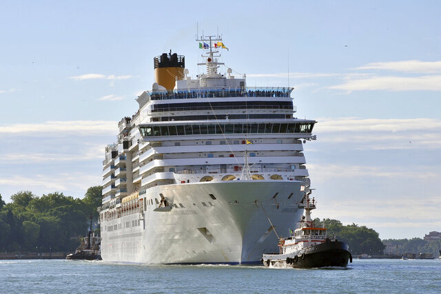 In this photo taken on Sunday, May 24, 2015, the Costa Deliziosa cruise ship leaves Venice, Italy. Passengers on a luxury liner's around-the-world cruise, which began before the globe was gripped by the coronavirus pandemic, are finally approaching their odyssey's end after 15 weeks at sea. Next week, the Costa Deliziosa is due to reach Spain and Italy, two of the countries most devastated by COVID-19 infections. (AP Photo/Luigi Costantini)