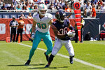 Chicago Bears defensive back DeAndre Houston-Carson, right, runs with the ball after he intercepts a pass against Miami Dolphins tight end Adam Shaheen during the first half of an NFL preseason football game in Chicago, Saturday, Aug. 14, 2021. (AP Photo/Nam Y. Huh)