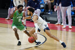 Villanova's Caleb Daniels (14) is defended by North Texas' JJ Murray (11) during the second half of a second-round game in the NCAA men's college basketball tournament at Bankers Life Fieldhouse, Sunday, March 21, 2021, in Indianapolis. (AP Photo/Darron Cummings)