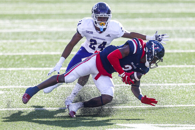 Liberty wide receiver Demario Douglas (3) carries the ball as he is defended by Western Carolina safety Quintin Talley (24) during the second half of an NCAA football game Saturday, Nov. 14, 2020, in Lynchburg, Va. (AP Photo/Shaban Athuman)