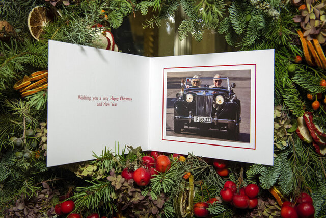 The 2019 Christmas card of Britain's Prince Charles and Camila, Duchess of Cornwall is displayed on a Christmas tree in Clarence House, London. Britain's Prince Charles has chosen an Associated Press photo taken on his historic trip to Cuba for his Christmas card. The image by AP's Ramon Espinosa shows the heir to the British throne behind the wheel of a classic car in Havana alongside his wife Camilla. (Dominic Lipinski/Pool via AP)