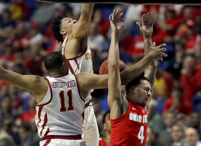 Ohio State's Duane Washington Jr. (4) loses control of the ball on his way to the basket as Iowa State's Talen Horton-Tucker (11) and Lindell Wigginton defend during the first half of a first round men's college basketball game in the NCAA Tournament Friday, March 22, 2019, in Tulsa, Okla. (AP Photo/Jeff Roberson)