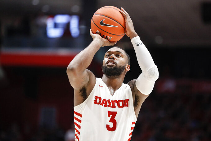 Dayton's Trey Landers takes a foul shot during the first half of the team's NCAA college basketball game against Virginia Commonwealth, Tuesday, Jan. 14, 2020, in Dayton, Ohio. (AP Photo/John Minchillo)