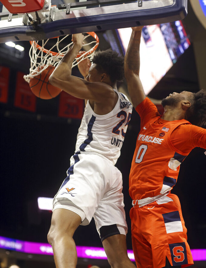 Virginia guard Trey Murphy III (25) dunks next to Syracuse forward Alan Griffin (0) during an NCAA college basketball game Monday, Jan. 25, 2021, in Charlottesville, Va. (Andrew Shurtleff/The Daily Progress via AP)