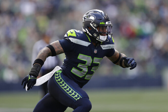 Seattle Seahawks strong safety Jamal Adams runs a play against the Tennessee Titans during the second half of an NFL football game, Sunday, Sept. 19, 2021, in Seattle. (AP Photo/John Froschauer)