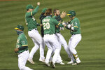 Oakland Athletics's Ramón Laureano celebrates with teammates after his single drove in the winning run against the Houston Astros during the ninth inning of a baseball game in Oakland, Calif., Wednesday, Sept. 9, 2020. (AP Photo/Jed Jacobsohn)