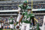 New York Jets' Jamal Adams (33) celebrates with Brian Poole (34) after Poole intercepted a pass and ran it back for a touchdown during the second half of an NFL football game against the Oakland Raiders, Sunday, Nov. 24, 2019, in East Rutherford, N.J. (AP Photo/Adam Hunger)