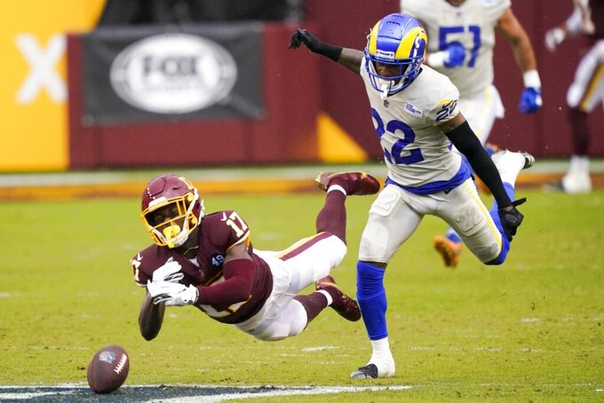 Washington Football Team's Terry McLaurin can't catch a pass in front of Los Angeles Rams' Troy Hill during the second half of an NFL football game Sunday, Oct. 11, 2020, in Landover, Md. (AP Photo/Susan Walsh)