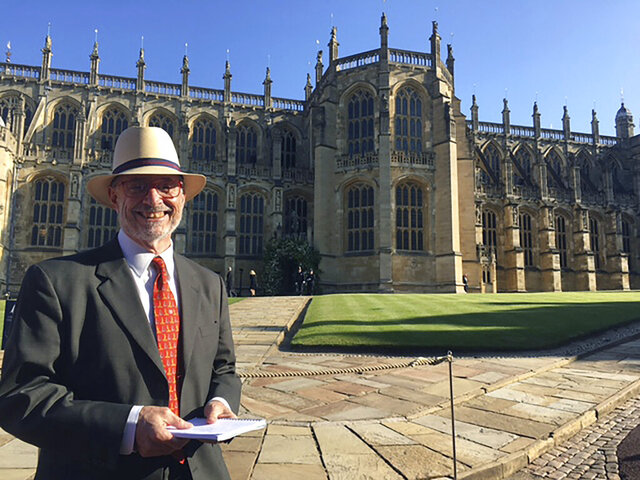 In this May 19, 2018 photo, Gregory Katz, acting London bureau chief for The Associated Press, stands in front of St. George's Chapel in Windsor near London, while covering the royal wedding of Prince Harry and Meghan Markle. Katz, a Pulitzer Prize winning journalist who recently led the AP's coverage of Brexit and the election of Boris Johnson as prime minister, died Monday, June 22, 2020. He had been ill in recent months and had contracted COVID-19. He was 67. (AP Photo)