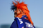 A New York Islanders fan walks outside Nassau Coliseum before Game 3 of the NHL Stanley Cup hockey semifinals against the Tampa Bay Lightning, Thursday, June 17, 2021, in Uniondale, N.Y. (AP Photo/Frank Franklin II)