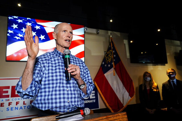 Sen. Rick Scott, R-Fla., speaks during a campaign rally for Republican candidates for U.S. Senate Sen. Kelly Loeffler and Sen. David Perdue on Friday, Nov. 13, 2020, in Cumming, Ga. (AP Photo/Brynn Anderson)