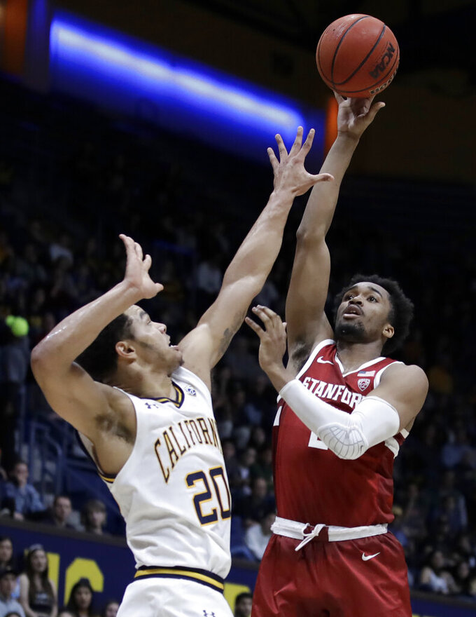 Stanford's Bryce Wills, right, shoots over California's Matt Bradley (20) in the first half of an NCAA college basketball game Sunday, Jan. 26, 2020, in Berkeley, Calif. (AP Photo/Ben Margot)