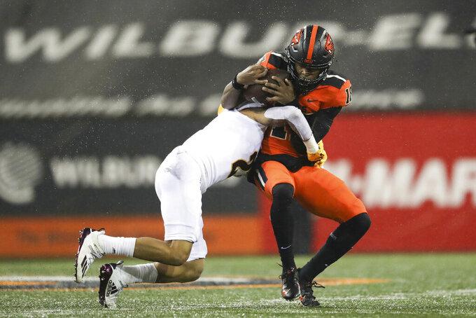 Arizona State defensive back DeAndre Pierce (2) brings down Oregon State wide receiver Zeriah Beason (18) during the first half of an NCAA college football game in Corvallis, Ore., Saturday, Dec. 19, 2020. (AP Photo/Amanda Loman)
