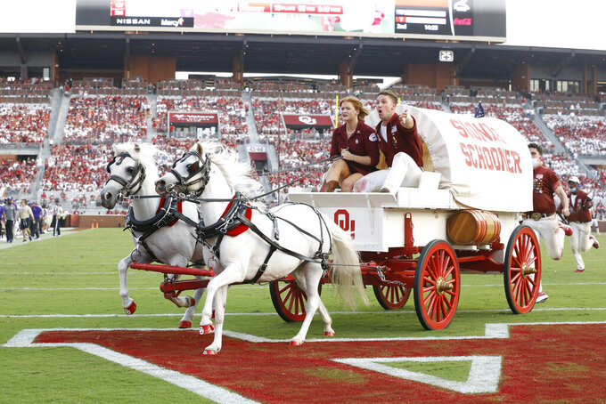 The Oklahoma Sooner Schooner heads across the field after an Oklahoma touchdown against Western Carolina during the first half of an NCAA college football game Saturday, Sept. 11, 2021, in Norman, Okla. (AP Photo/Alonzo Adams)