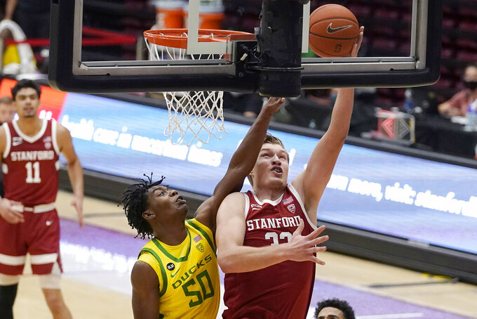 Stanford forward Lukas Kisunas, right, shoots against Oregon forward Eric Williams Jr. (50) during the second half of an NCAA college basketball game in Stanford, Calif., Thursday, Feb. 25, 2021. (AP Photo/Jeff Chiu)