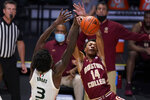 Miami center Nysier Brooks (3) blocks a shot by Boston College forward Kamari Williams (14) during the first half of an NCAA college basketball game, Friday, March 5, 2021, in Coral Gables, Fla. (AP Photo/Wilfredo Lee)