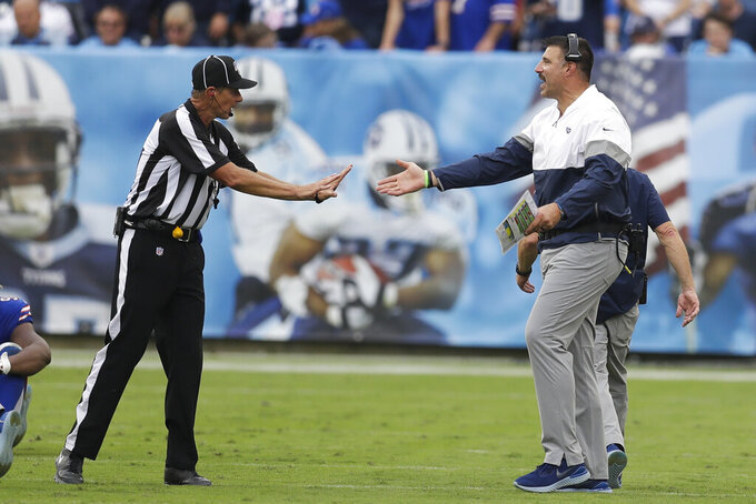 Tennessee Titans head coach Mike Vrabel argues with down judge Kent Payne in the second half of an NFL football game against the Buffalo Bills Sunday, Oct. 6, 2019, in Nashville, Tenn. (AP Photo/James Kenney)