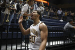 California guard Matt Bradley (20) celebrates after hitting the winning basket in overtime against Washington during the second half of an NCAA college basketball game in Berkeley, Calif., Saturday, Jan. 11, 2020. (AP Photo/Jed Jacobsohn)