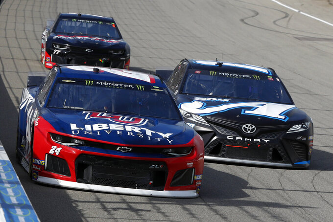 William Byron (24), Martin Truex Jr. (19) and Garrett Smithley (77) race into turn one during a NASCAR Cup Series auto race at Michigan International Speedway in Brooklyn, Mich., Sunday, Aug. 11, 2019. (AP Photo/Paul Sancya)