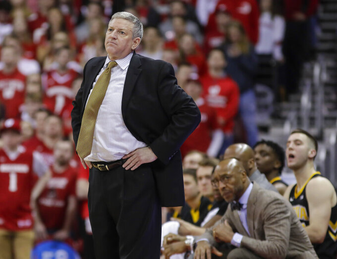 Iowa assistant coach Kirk Speraw watches his team during the second half of an NCAA college basketball game against Wisconsin on Thursday, March 7, 2019, in Madison, Wis. Wisconsin won 65-45. Iowa head coach Fran McCaffrey has been suspended for two games. (AP Photo/Andy Manis)