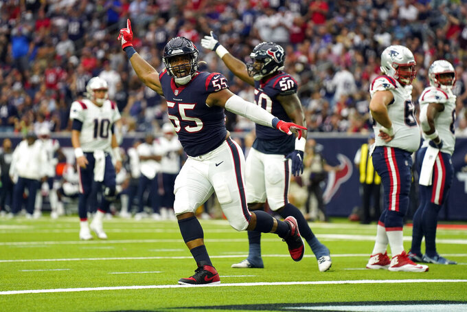 Houston Texans defensive end DeMarcus Walker (55) and defensive end Jordan Jenkins (50) celebrate after the Texans recovered a fumble by New England Patriots running back Damien Harris during the first half of an NFL football game Sunday, Oct. 10, 2021, in Houston. (AP Photo/Eric Christian Smith)